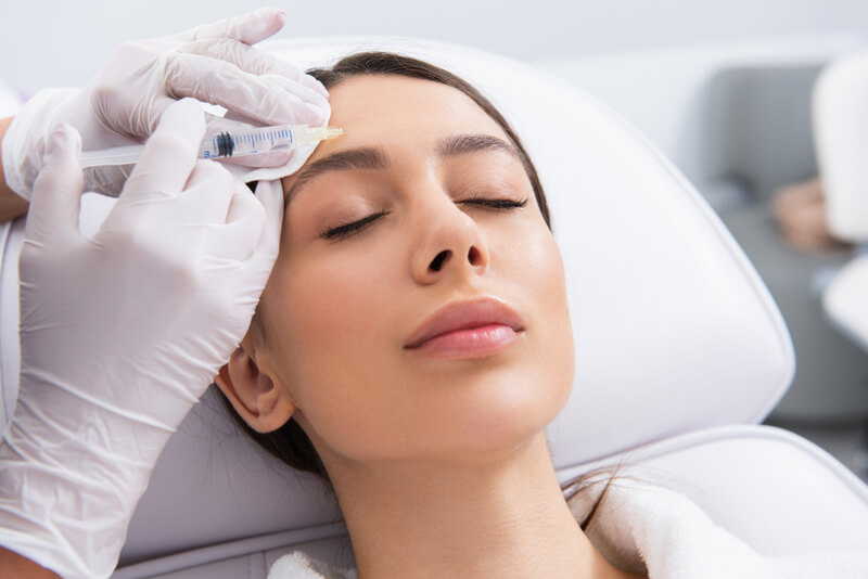 injecting dermal fillers for forehead contouring
